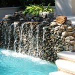 Water Fall Fountain On Rocks Of Swimming Pool