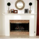 White Fireplace Design With Awesome Kit And Accessories Above