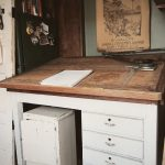 White Wooden Classic Darfting Table With Chair And Drawers In A Nook