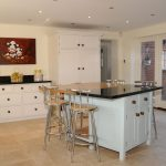 White Wooden Stand Alone Kitchen Islands With Black Design On Top Metal Grey Stools And White Cabinet