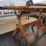 Wooden Drafting Table In Room With Hardwood Floor And Cream Decorative Carpet
