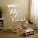 Wooden Modern Rocking Chair For Nursery With Footer Fur Rug And Small Basket