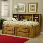 Wooden Rustic Style Twin Bed With Drawers Underneath With Fruit Bedding And Red Rug