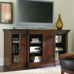 Wooden Tall Media Chest With Triple Doors Grey TV And Fur Rug