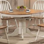 Wooden White Round Table WIth Four Chairs And Simple Carpet