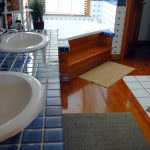 wood floor bamboo bath tub rug window plants sink