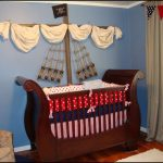 A nursery room decorating idea with pirate theme a unique baby crib made of hardwood