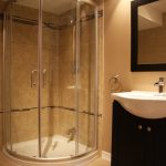 A standup shower room with white framed glass door idea