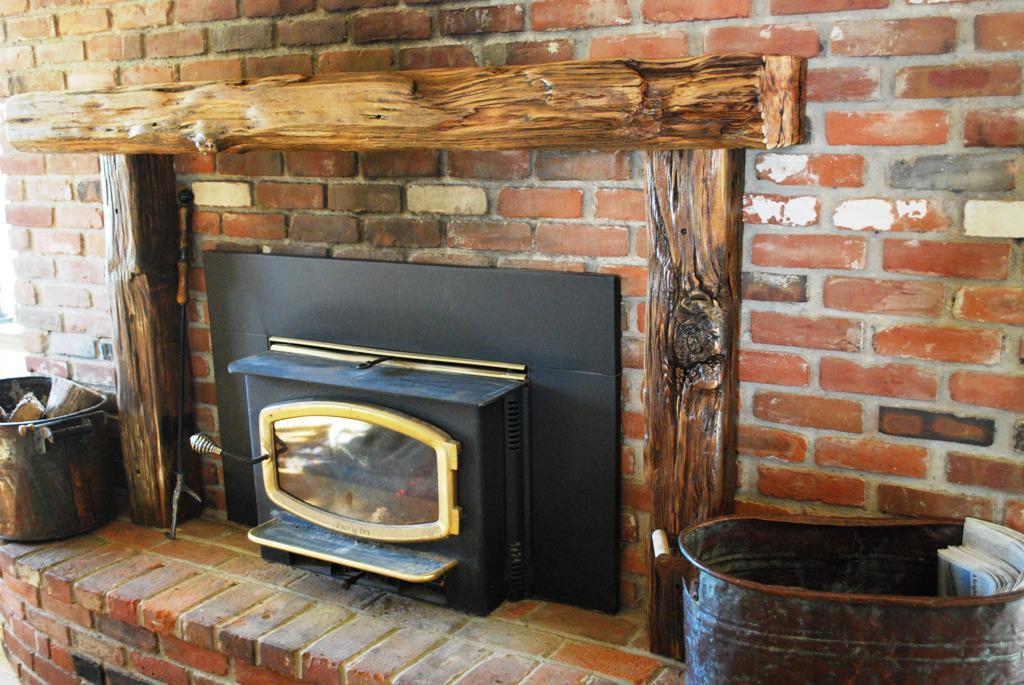 Reclaimed wood mantels for a rustic or antique fireplace for Wood fireplace surround designs