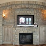 Awesome Design Of Stone Fire Places With TV And Double Cabinet Plus Double Lamps