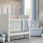 Babyboy nursery theme idea in white a white baby crib a corner nursery chair a white baby changing desk with storage underneath
