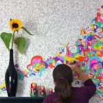 Creative hand painting applied on washable painted wall system