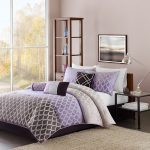 Dark gray and purple bedding set with modern motifs for standard size platform bed with lower headboard a glass top side table with modern table lamp