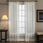 Double White Lace Window Shades With Rods Side Table And Table Lamp