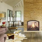 Double sided gas fireplace idea with thin black frame and curved shape on top