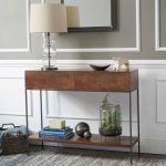 IKEA console table with shelf underneath a modern table lamp