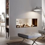 Minimalist style gas fireplace in double sided version a modern white couch a modern white center table with cushion a modern floor lamp