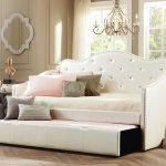 Oversize daybed with white upholstery tufted headboard and additional trundle in white