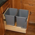 Pull out kitchen storage with gray recycle bins