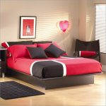 Queen sized South Shore bed frame with black finish medium size black mat a black corner chair