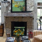 Reclaimed wood mantel for a rustic style fireplace a set of living room furniture with orange strips decoration