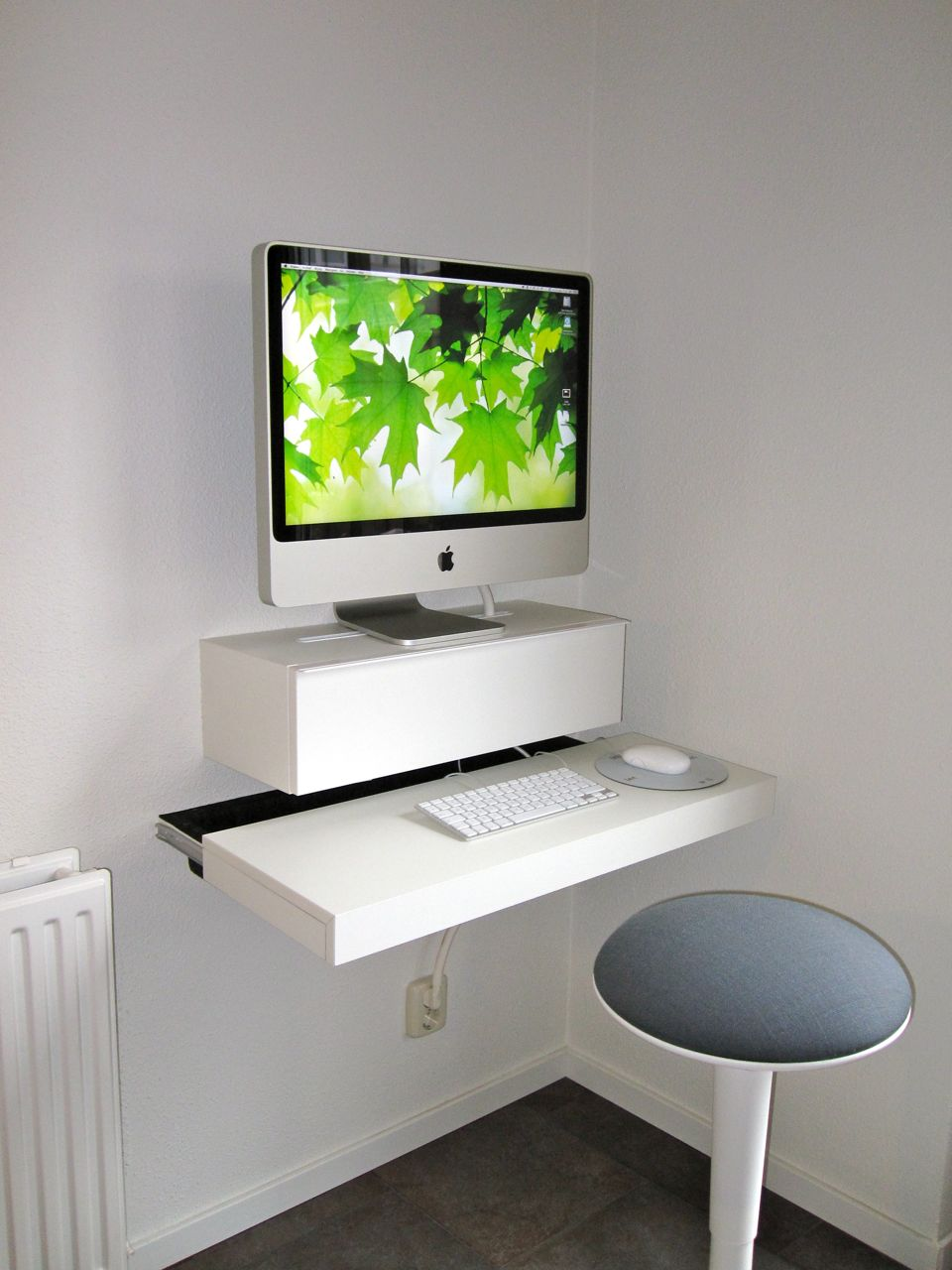 Simple And Minimalist Ikea Floating Computer Desk In White A Round Top Chair Without Back Feature
