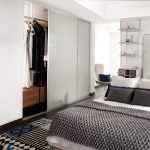 Simple and modern white sliding door closet design idea a queen size bed frame with pillows