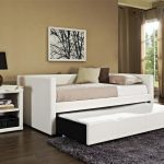 Simple minimalist white daybed with pull out trundle white side table with shelves underneath wool gray area rug