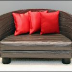 Small half circle couch with scarlet throw pillows
