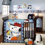 Snoopy nursery room theme idea with dark brown painted wood baby crib
