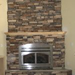 Stone Fire Places With Grey Metal Fire Spot