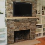 Stone Fire Places With Wood Mantel And TV