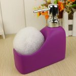 Sweet purple bodysoap bottle as well as a bath sponge stand