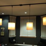 Track Lighting With Pendants And Four Lamps Plus Shades On WIndows