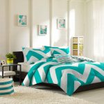 Turquoise and white bedding set with modern pattern white fluffy bedroom rug glass top bedside table high and narrow storage system with handles