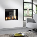 Two sided modern gas fireplace for modern minimalist home a reading chair white area rug