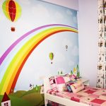 Washable wall paint idea for a kid's room twin size bed frame with colorful bed sheet and pillow cases