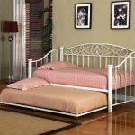 White metal finished daybed with pull out trundle addition by IKEA
