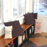 Wooden Long Bench With Storage For Books Plus Brown Pillows