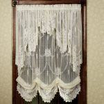 Wooden Window Frame With White Lace Window Shades
