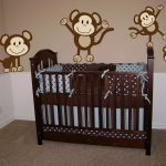 a nursery room theme idea with cute monkey pictures dark brown painted baby crib made of hardwood