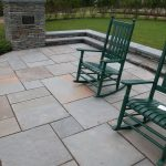 blue stone pavers in different sizes for patio a pair of wooden rocking chairs
