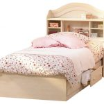 twin sized  South Shore bed frame with headboard and twin storage underneath