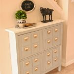 white console table with a lot of storage units
