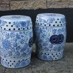 A pair of blue and white garden stools
