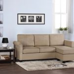 Beige sectional sofa with chaise for small space small white fluffy rug dark finished wood side table high and narrow built in shelves