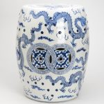Blue and white oriental garden stool with dragon pictures