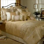 Gold toned bedding set idea for a luxurious modern bedroom