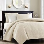 Soft beige and white bedding set with comforter