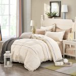 Soft beige and white bedding set with decorative lines
